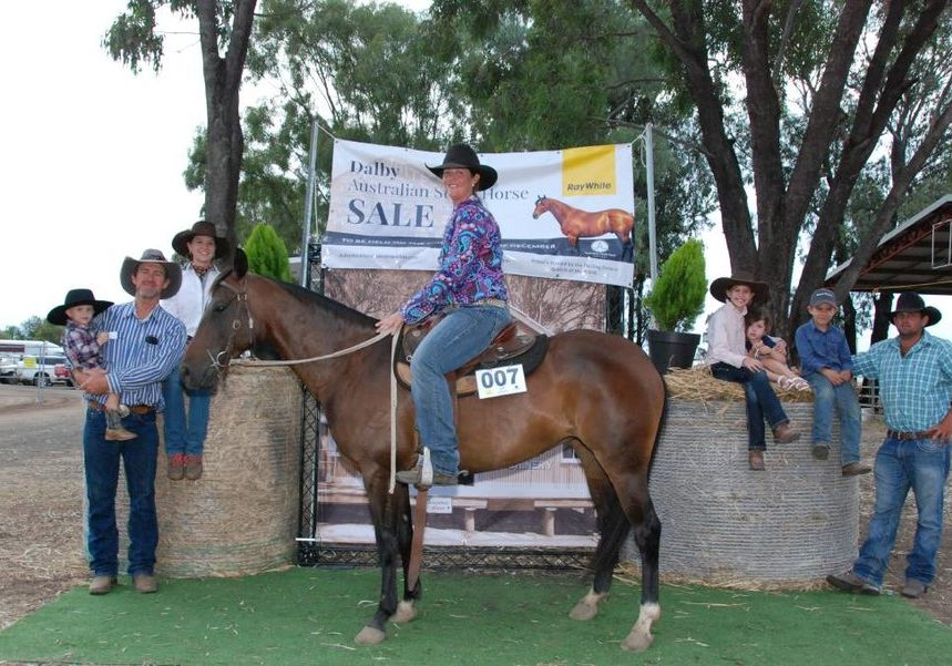 Kerrie Thompson riding Oneofakind Dixie Chic mare who topped the Dalby Australian Stock Horse Sale at $54,000 with buyer Andy Mulcahy (left), holding son Hugh Mulcahy and daughter Amy Mulcahy, Lily Mulcahy (right), Rose Habermann, Andy Mulcahy Jr and horse co-owner Zane Habermann.